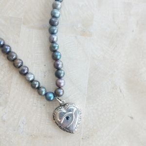 Sterling silver wishbone heart bead necklace